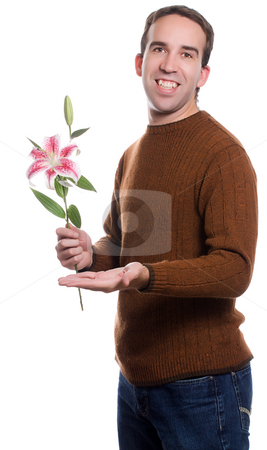 Man On A Date stock photo, A young man offering a lily to someone unseen, isolated against a white background by Richard Nelson