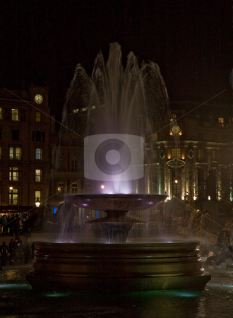 Fountain by night stock photo, Trafalgar Square London Fountain by Night by Susan Robinson