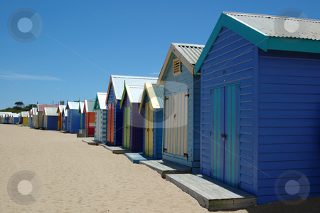 Colorful boat houses on Brighton Beach Australia stock photo, Brightly colored boat houses line the beach in Brighton, Australia by Lee Torrens