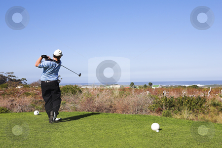 Golf #11 stock photo, Man playing golf. by Sean Nel