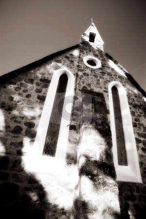 Church steeple stock photo, Catholic church building with a cross on the steeple - high key black and white, defocussed by Sean Nel