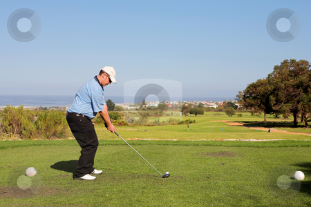 Golfer #54 stock photo, A golfer playing golf on a green. by Sean Nel