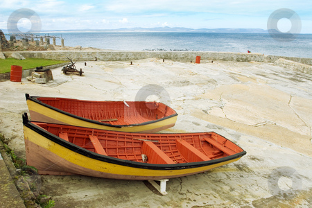 Harbour #1 stock photo, Two red and yeallow derelict boats on Hermanus Harbour, South Africa by Sean Nel