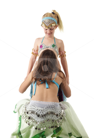 Two young belly dancing girls stock photo, Two young Caucasian belly dancing girls in beautiful decorated clothes on white background. Not isolated by Sean Nel