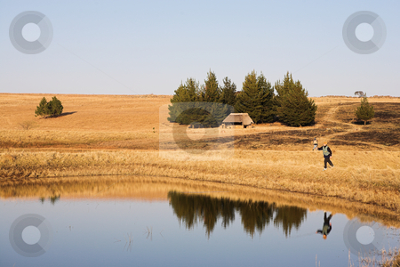 Flyfish #47 stock photo, A fly fisherman casting a line in Dullstroom, South Africa by Sean Nel
