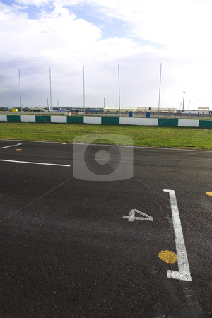Starting grid for racetrack stock photo, Starting grid in front of the pit lane of Killarney Race Track in the Western Cape, South Africa. Cloudy and wet race day. by Sean Nel