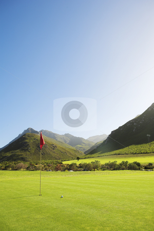 Golf #54 stock photo, Golf course with a red flag. by Sean Nel