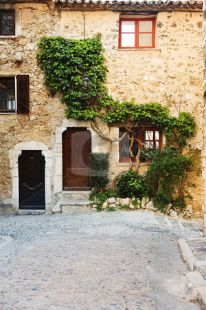 Village of St Paul stock photo, Buildings with windows and doors in the quaint little French hilltop village of Saint-Paul de Vence, Southern France,  Alpes Maritimes, next to the Mediterranean sea by Sean Nel