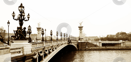 Pont Alexandre III  stock photo, Pont Alexandre III - Bridge in Paris, France.  Movement on cars driving ? Gloomy winters day. Copy space, sepia tone by Sean Nel
