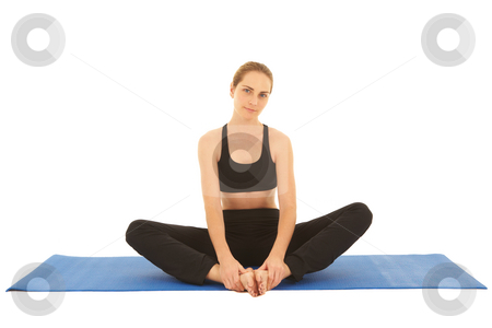 Pilates exercise series stock photo, Fit young brunette pilates instructor showing different exercises on a white background a blue yoga mat. White background NOT ISOLATED by Sean Nel
