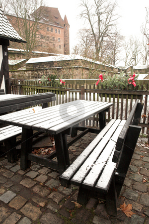 Munich #54 stock photo, Wintertime in Neurenburg - Munich:  A table and  benches covered in snow. by Sean Nel