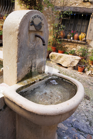 Village of St Paul stock photo, Fresh water fountain in the centre of the quaint little French hilltop village of Saint-Paul de Vence, Southern France,  Alpes Maritimes, next to the Mediterranean sea - A Heritage Site by Sean Nel