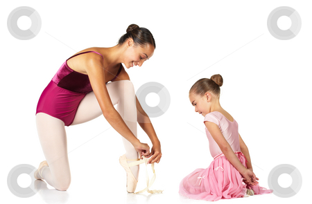 Tying ballet shoes stock photo, Young female ballet dancer showing a young dancer how to tie a ballet Pointe Shoe against a white background. NOT ISOLATED by Sean Nel