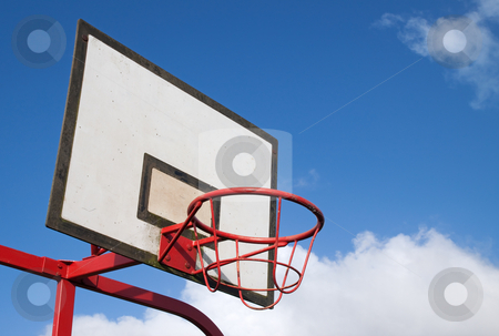 Park basketball ring close up and blue sky. stock photo, Park basketball ring close up and blue sky. by Stephen Rees