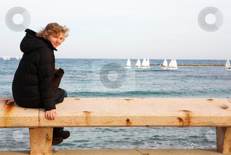 Antibes #64 stock photo, Tourist sitting on a bench overlooking the sea in Antibes, France.  Copy space. by Sean Nel