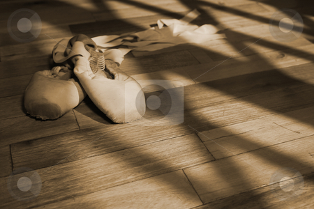 Pointe Shoes #2 stock photo, Pair of Ballet shoes lying on a wooden studio floor - Sepia Tone by Sean Nel
