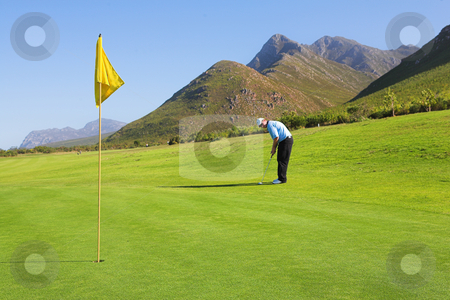 Golfer #47 stock photo, A golfer playing golf on a green. by Sean Nel