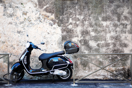 Antibes #59 stock photo, Scooter in front of a wall. Copy space. by Sean Nel