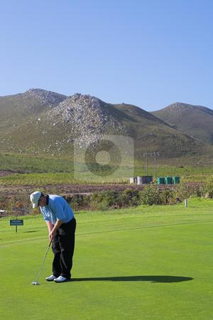 Golfer #52 stock photo, A golfer playing golf on a green by Sean Nel