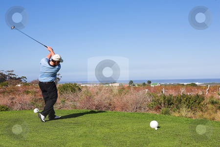 Golfers #61 stock photo, A golfer playing golf on a green.  Movement on the golf club. by Sean Nel