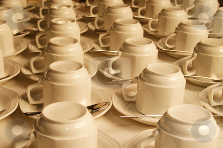 Cups in a row stock photo, Upside down cups stacked in rows, ready for use by Sean Nel