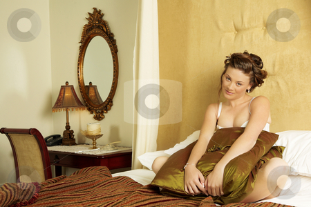 Lingerie#270 stock photo, Woman in underwear sitting on a bed. by Sean Nel