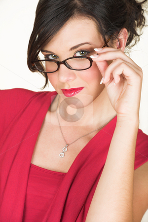 Young caucasian businesswoman stock photo, Young adult brunette businesswoman with horn rimmed glasses and a red dress. She is Caucasian and wears bright red lipstick. NOT ISOLATED by Sean Nel