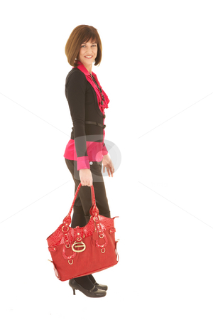 Sexy brunette businesswoman stock photo, Sexy young adult Caucasian businesswoman in a red and black office outfit against a white background with a red leather bag. NOT ISOLATED by Sean Nel