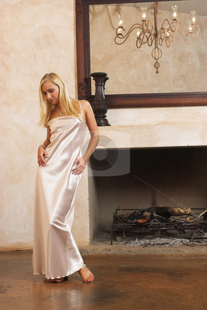 Lingerie #23 stock photo, Blonde woman with bare feet in silk lingerie by Sean Nel