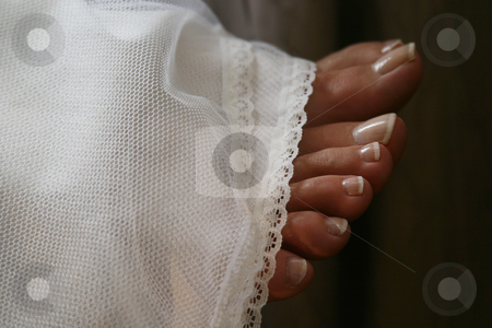 Toes stock photo, Toes sticking out from wedding gown by Sean Nel