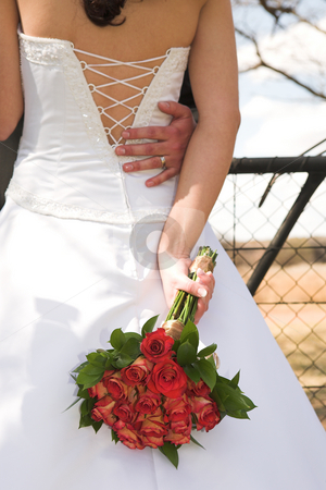 Bride #9 stock photo, Young Bride with white wedding gown - Luxurious red roses behind her back by Sean Nel
