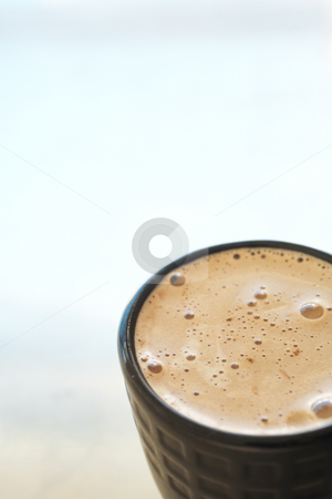 Cafe latte in coffee mug stock photo, Fresh foamy cafe latte in black coffee mug on a silver background with lots of copy space ? Shallow Depth of Field, focus on Foam by Sean Nel