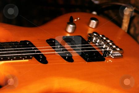Bass guitar stock photo, Orange Bass guitar by Sean Nel