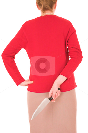 Blonde Murderess woman stock photo, Blonde middle aged woman with a large carving knife hidden behind her back against a white background by Sean Nel