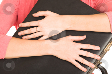 Businesswoman #418 stock photo, Close-up of hands of a business lady, holding a black leather suitcase. by Sean Nel