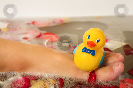 Woman #189 stock photo, Foot of a woman with a plastic toy duck on it.  Shallow D.O.F by Sean Nel