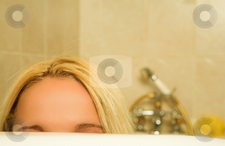 Woman #168 stock photo, Woman peeking over a bath.  Shallow D.O.F by Sean Nel