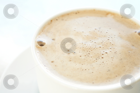 Cafe latte in coffee cup stock photo, Fresh foamy cafe latte in white coffee cup on a silver background ? Shallow Depth of Field, focus on Foam by Sean Nel