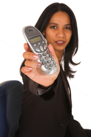 Isolated Businesswoman holding telephone  stock photo, Businesswoman with brown hair, dressed in a white shirt with black suit jacket holding a portable PABX telephone. Shot on White Background, Shallow Depth of Field  by Sean Nel