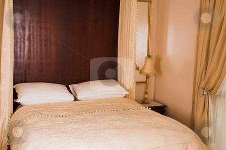 Luxurious bedroom interior stock photo, Interior of a luxurious bedroom in a guesthouse by Sean Nel
