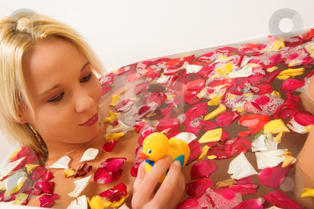 Woman #183 stock photo, Nude woman in a bath, holding a plasic toy duck. by Sean Nel