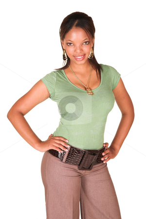 African businesswoman isolated on white stock photo, A short smiling African businesswoman with brown trousers and a short sleeved green top and a faux leather belt. She has one arm in her side and is smiling at the viewer. Isolated on white. by Sean Nel