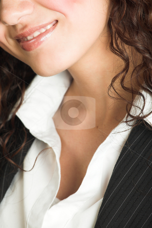Young adult businesswoman stock photo, Portrait of a beautiful young adult Caucasian businesswoman with light skin and curly brown hair, brown eyes and pink lips, wearing a pinstripe Jacket and white shirt by Sean Nel