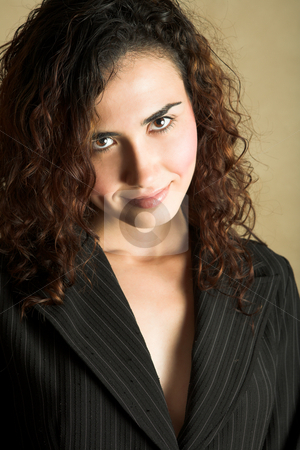 Young adult woman stock photo, Portrait of a beautiful young adult Caucasian woman with light skin and curly brown hair, brown eyes and pink lips, wearing a pinstripe Jacket by Sean Nel