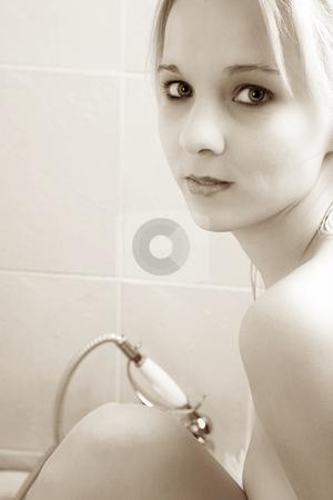 Woman #142 stock photo, Nude woman in a bath.  Copy space.  Sepia tone. by Sean Nel