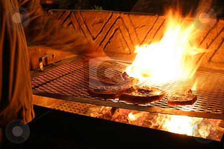 Flamed Steaks stock photo, Flame grilled steaks by Sean Nel