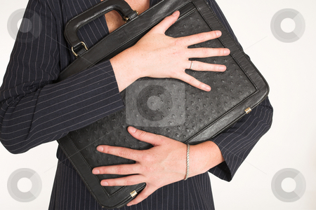 Laura Hopton #15 stock photo, Business woman holding black leather suitcase by Sean Nel