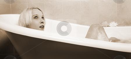 Woman #29 stock photo, Nude woman in a bath.  Sepia tone. by Sean Nel