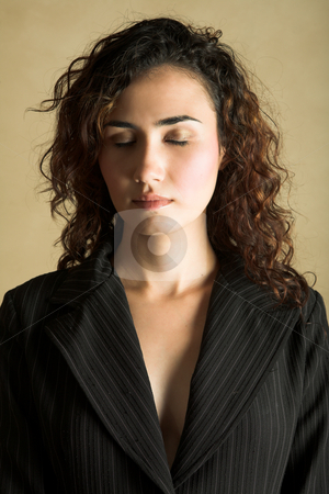 Young adult woman stock photo, Portrait of a beautiful young adult Caucasian woman with light skin and curly brown hair, closed eyes and pink lips, wearing a pinstripe Jacket by Sean Nel