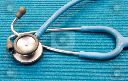 Medical Equipment #3 stock photo, Lightweight medical Stethoscope on blue examination matt by Sean Nel